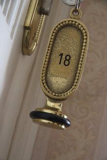 Hotel key in a room door, close-up - TL00204