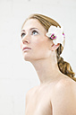 Young woman with flower in hair, close-up - CK00190