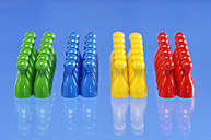 Game pieces in a row, close-up - AS03402
