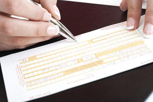 Person filling in a money transfer form - 07569CS-U
