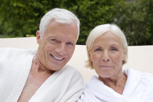 Germany, senior couple wearing bathrobes, close-up - BABF00375