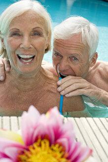 Germany, Senior couple in pool ,having fun close-up - BABF00258