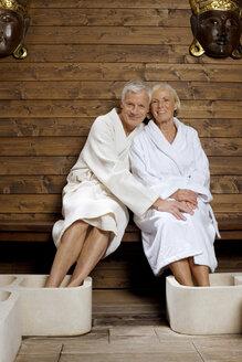 Germany, Senior couple wearing bath robes - BABF00231
