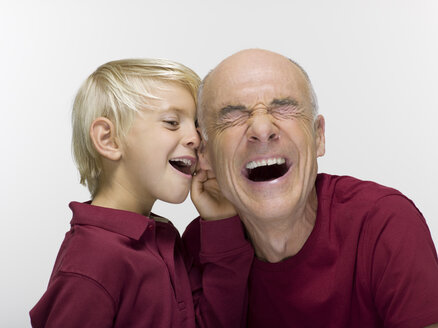 Grandson and grandfather, laughing, portrait, close-up - WESTF06467