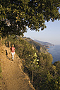 Italy, Liguria, Vernazza, Woman hiking on pathway - MRF01021