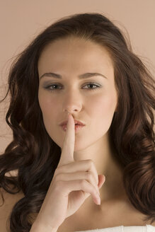 Woman with finger on her lips, portrait - RRF00060