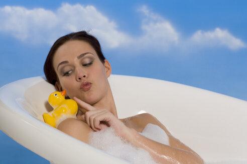 Young woman taking bubble bath - RRF00024