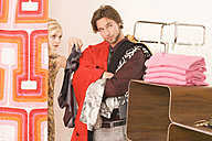 Young couple in the fitting room of a clothing store - WESTF07057
