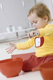 Baby girl (2-3) with bowl and egg beater - SMOF00142