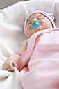 Baby girl (6-9 months) sleeping with pacifier, close-up - SMOF00106