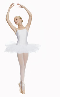 Young ballerina (14-15) standing on pointe in toe shoes,, portrait - KMF01157