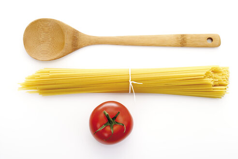 Bundle of spaghetti, wooden spoon and tomato, elevated view - 08078CS-U