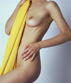 Naked young woman holding bath towel - HKF00064