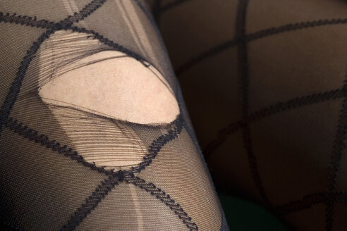Woman wearing nylons with hole - HK00018