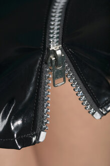 Woman wearing PVC miniskirt, close-up - HK00013