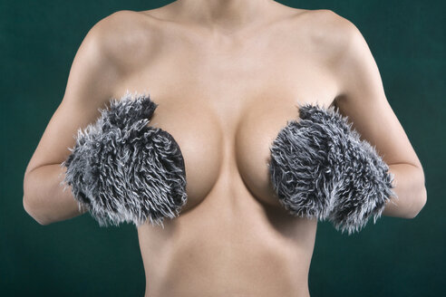 Woman covering her breast, mid section - HK00010