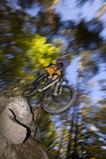 Italy, Southern Tyrol, man mountain biking - FFF00848