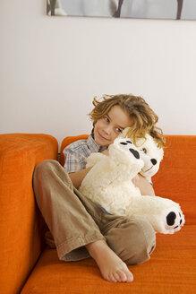 Boy (6-7) hugging teddy bear, portrait - WESTF07290