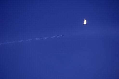 Germany, Markdorf, Airplane in the sky with half moon - SMF00315