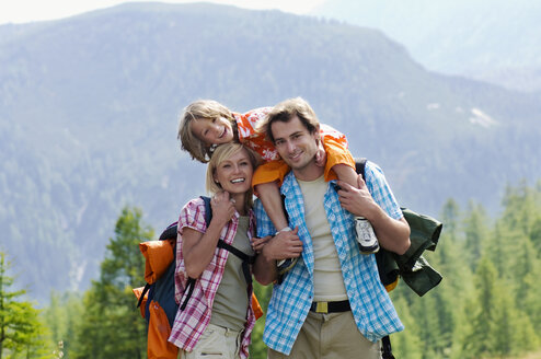 Austria, Salzburger Land, couple with son (8-9) hiking - HHF01805