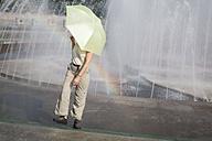 China, Shanghai, person walking under umbrella - GWF00582