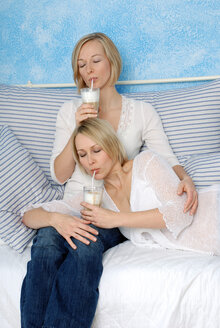 Two blonde women drinking white coffee, portrait - DKF00146