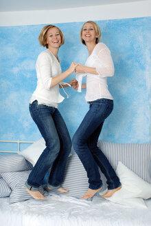 Two women fooling about, portrait - DKF00140