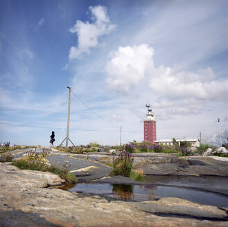 Finland, Lightouse Island, Woman standing alone - PM00535