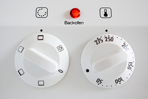 Knobs on oven, full frame, close-up - MU00362
