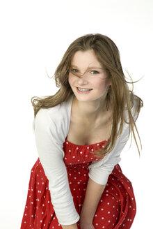 Brunette girl (13-14) in red dress, portrait - NHF00736