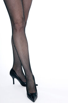 Female legs, High heels and fish net stockings - 00374LR-U