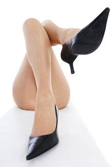 Female legs in high heels, close up - 00371LR-U