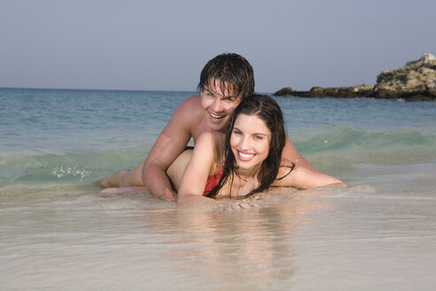 Asia, Thailand, Couple lying on beach - RDF00675