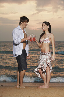 Asia, Thailand, Young couple having drink, portrait - RDF00616