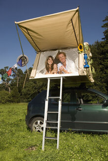 Germany, Bavaria, Young couple laying in tent - RDF00576