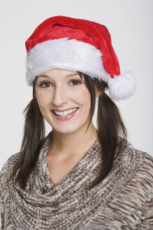 Young woman wearing Santa Claus hat, portrait - RDF00848