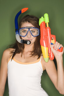 Young woman with diving goggles and water pistol - RDF00759