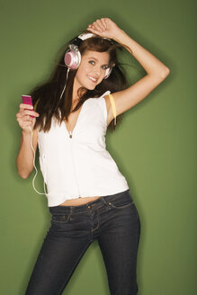 Young woman listening to music from MP3 player - RDF00756