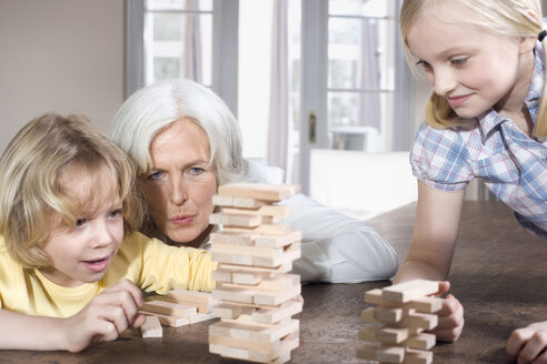 Grandmother and grandchildren (8-9) playing together, portrait - WESTF08269