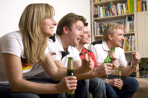Soccer Fans watching Soccer Game on Television - GAF00012