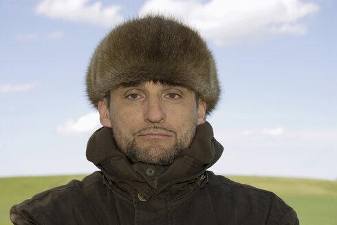 Germany, Bavaria, Man with fur cap, portrait - NHF00776