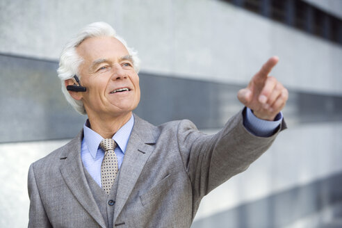 Germany,Baden Württemberg, Stuttgart, Senior Business man wearing headset - WEST08418