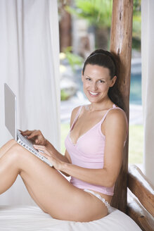 Young woman in underwear using laptop - ABF00353
