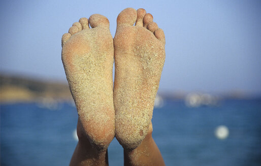 Italy, Sardinia, Tuaredda, One pair of sandy woman's feet, close-up - LFF00128