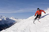 Austria, Salzburger Land, Altenmarkt- Zauchensee, Man skiing - HH02470