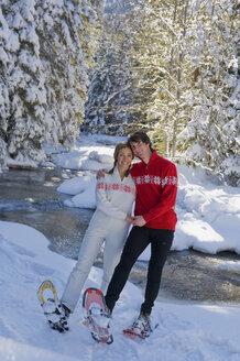 Austria, Salzburger Land, Altenmarkt-Zauchensee, Young couple in snowshoes - HH02533