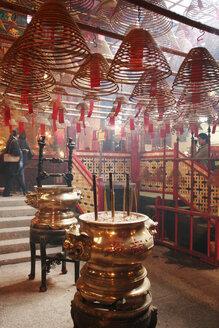 China, Hong Kong, Man Mo Temple, spiral coils of incense, slips of papers with prayers - GA00050