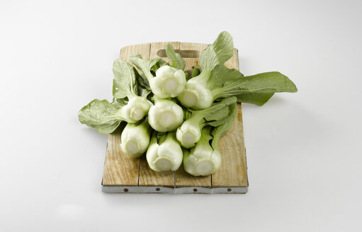 Bok choy, Chinese celery cabbage on chopping board - KSWF00169