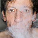 Man exhaling cigarette smoke, close-up, portrait - MUF00573