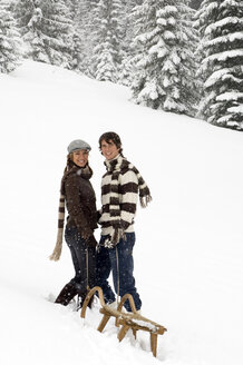 Austria, Salzburger Land, Altenmarkt, Young couple with a sled - HH02591